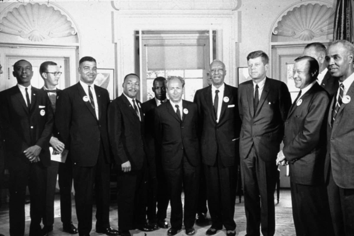 John Lewis stands to the left of Martin Luther King Jr. as President Kennedy meets with leaders of the March on Washington at the White House on August 28, 1963. (Photo by MPI/Getty Images)
