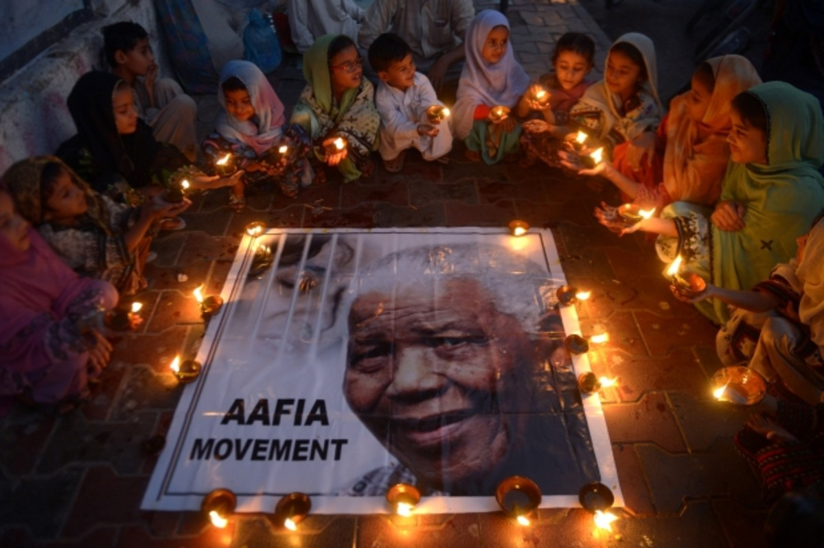 The Afterglow: Children in Pakistan pay tribute to Nelson Mandela on December 6, 2013. (Getty)