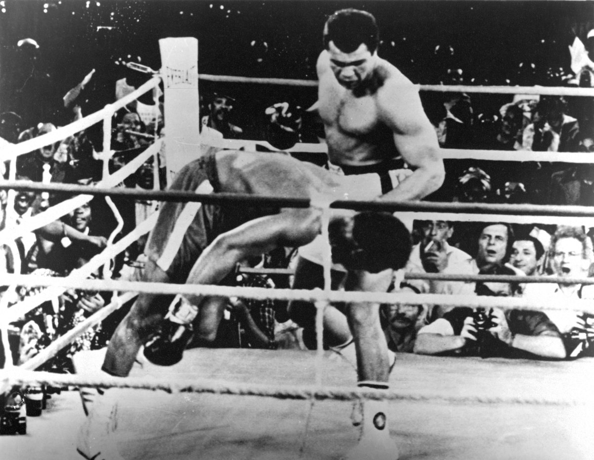 Muhammad Ali: After successfully taking on Joe Frazier, Muhammad Ali sets his sights on George Foreman for a match known as 'The Rumble in the Jungle' in Zaire, Africa on October 30, 1974. In spite of Foreman's impressive record as the undefeated world heavyweight champion, Ali won by knock out in the eighth round of the match, regaining his title as heavyweight champion of the world. (Photo by:  The Ring Magazine/Getty Images)