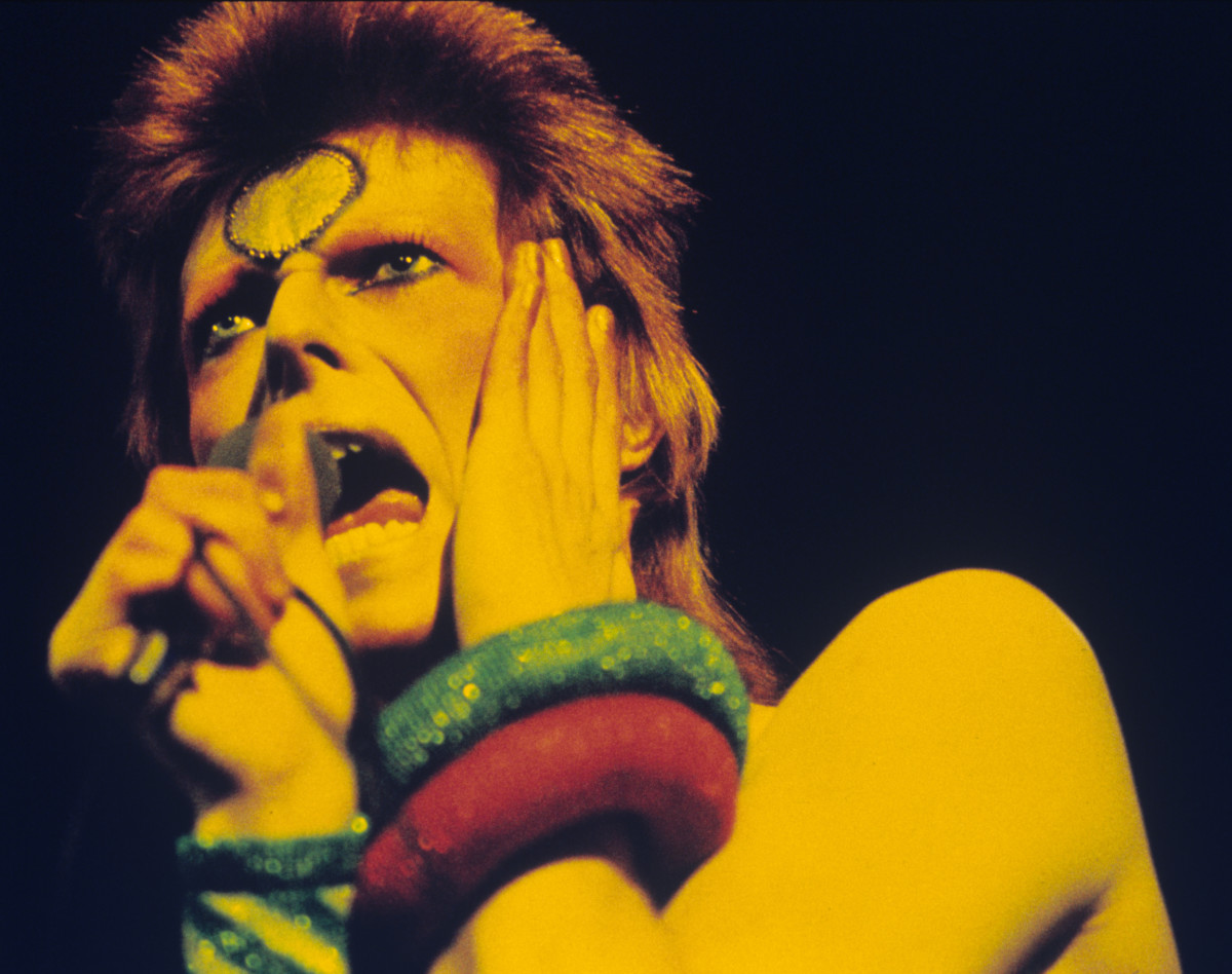 David Bowie: Bowie, as his glam-rock creation Ziggy Stardust, performs live at Earls Court Arena during his 1973 Ziggy Stardust tour (Photo by Gijsbert Hanekroot/Redferns)