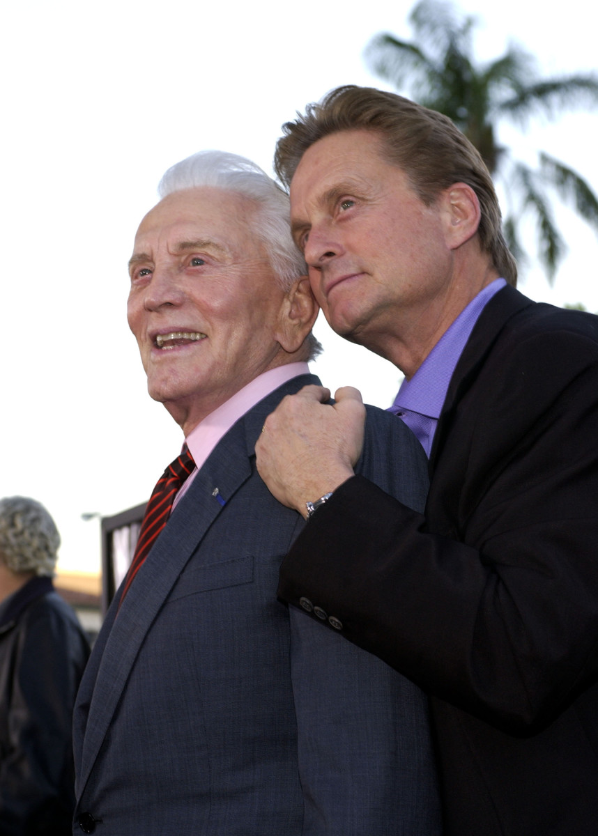 Kirk Douglas: Douglas and his younger 'twin,' Michael, have a father-son moment during the It Runs in the Family premiere in Westwood, California, in 2003. (Photo: WireImage)