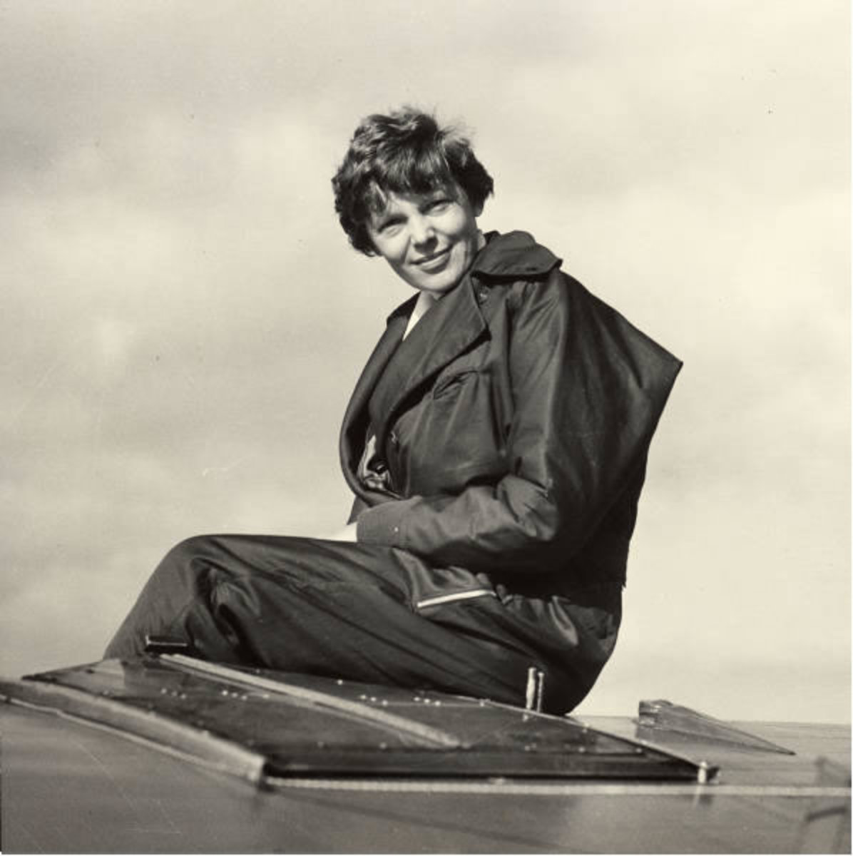 Amelia Earhart: Amelia Earhart sitting on her plane, ca. 1935. George Palmer Putnam Collection of Amelia Earhart Papers, Courtesy of Purdue University Libraries, Karnes Archives and Special Collections.