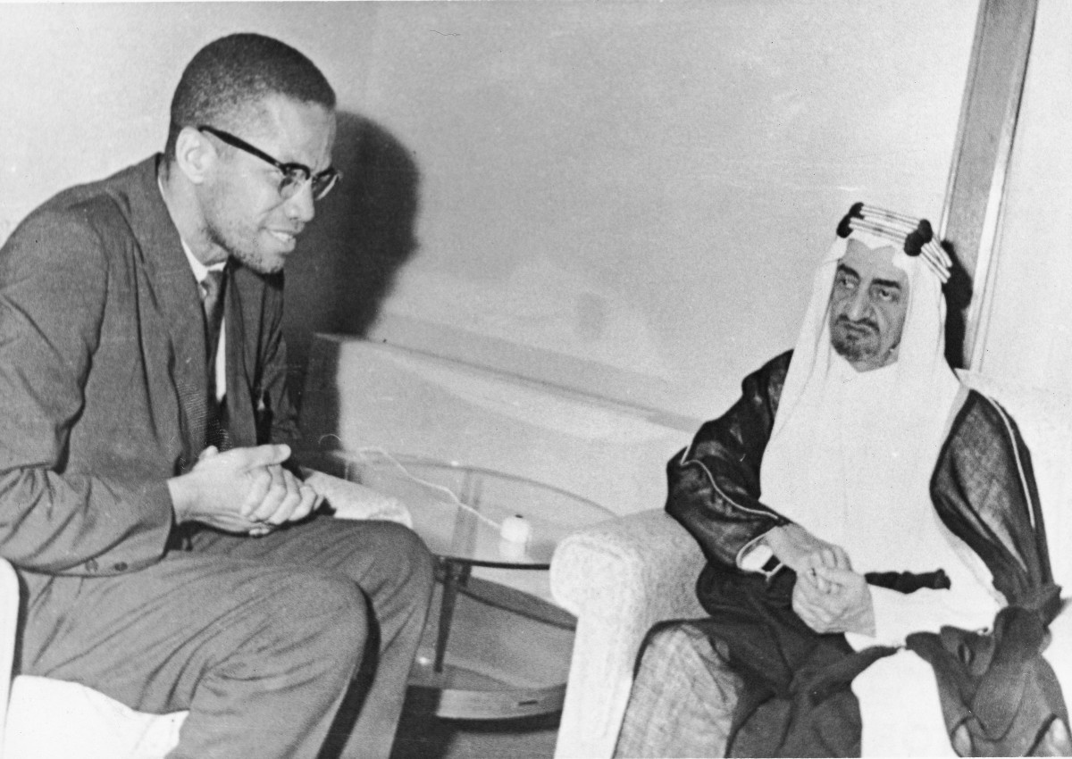 Malcolm X sits down with Prince (later King) Faisal al-Saud, the regent of Saudi Arabia, during a pilgrimage to the Muslim holy city of Mecca in April 1964.