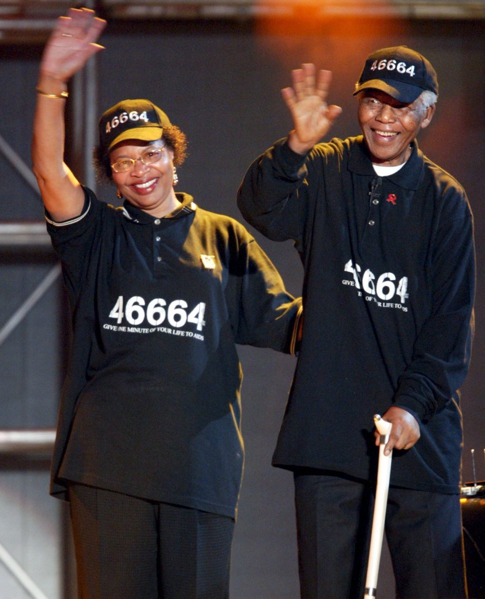 Nelson Mandela and his wife, Graca Machel, wave to the crowd after his address during the second 46664 AIDS Benefit Concert in 2005.