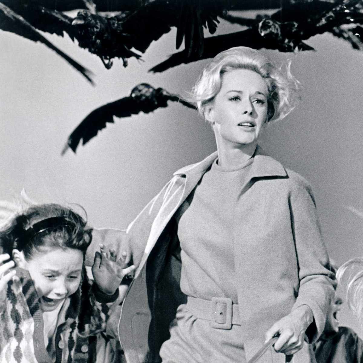 Tippi Hedren running from Hitchock's birds. (Photo: Universal Pictures/Photofest)