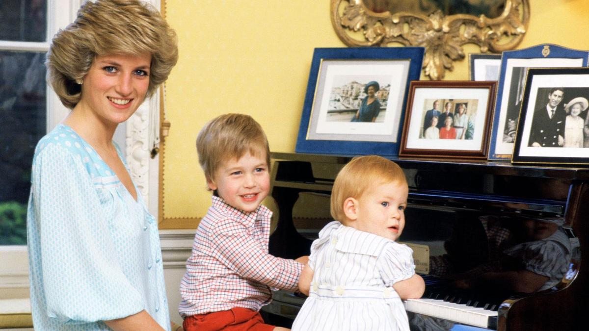 Diana, Princess of Wales with her sons, Prince William and Prince Harry, at the piano in Kensington Palace on October 4, 1985.