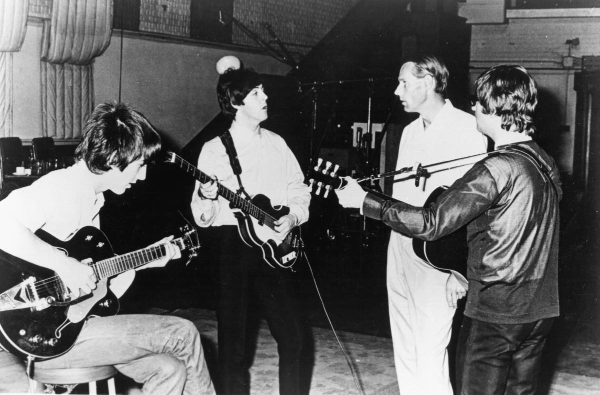 The Beatles and George Martin circa 1964