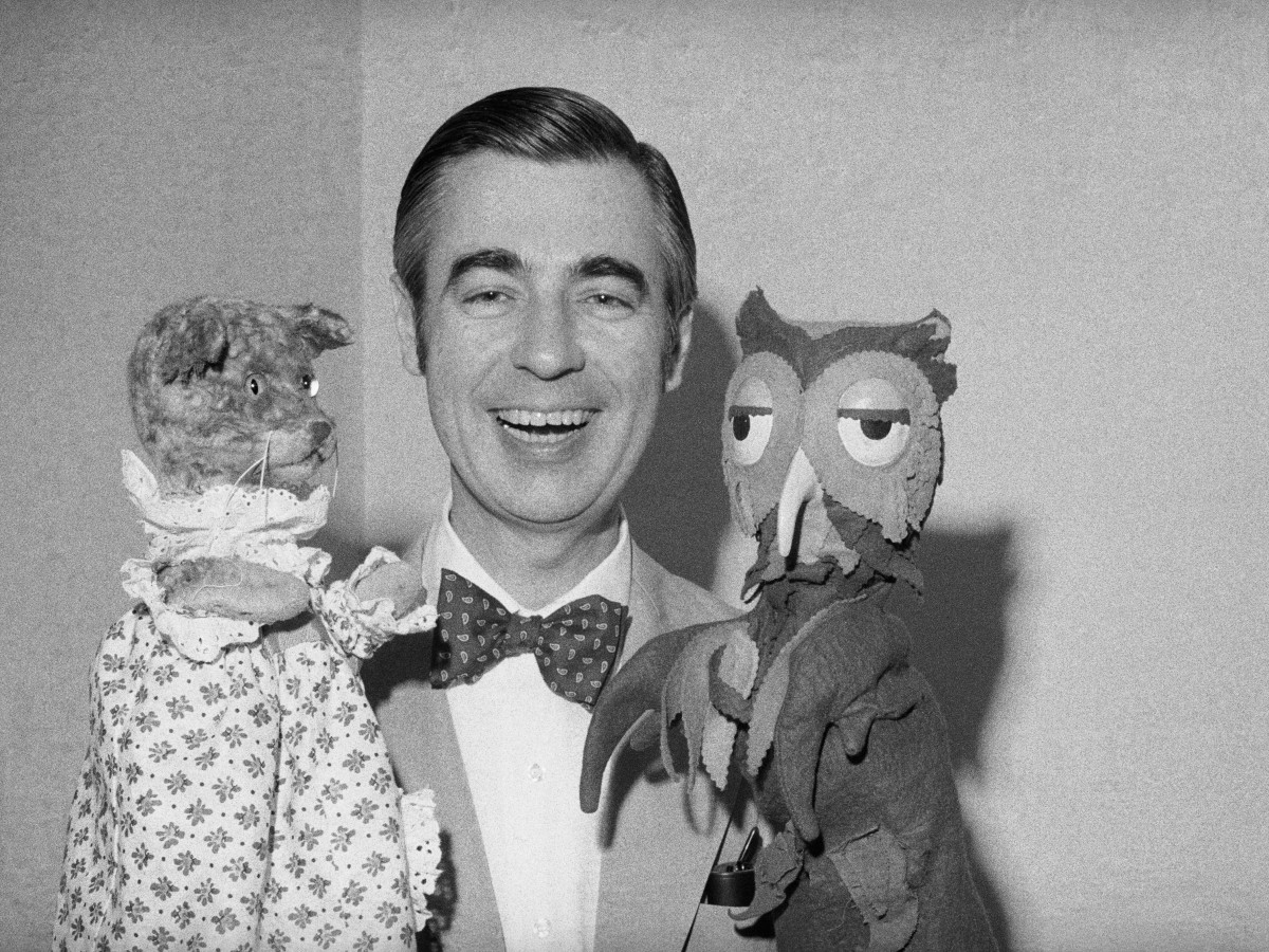 Mister Rogers holds Henrietta Pussycat (left) and 'X' the Owl