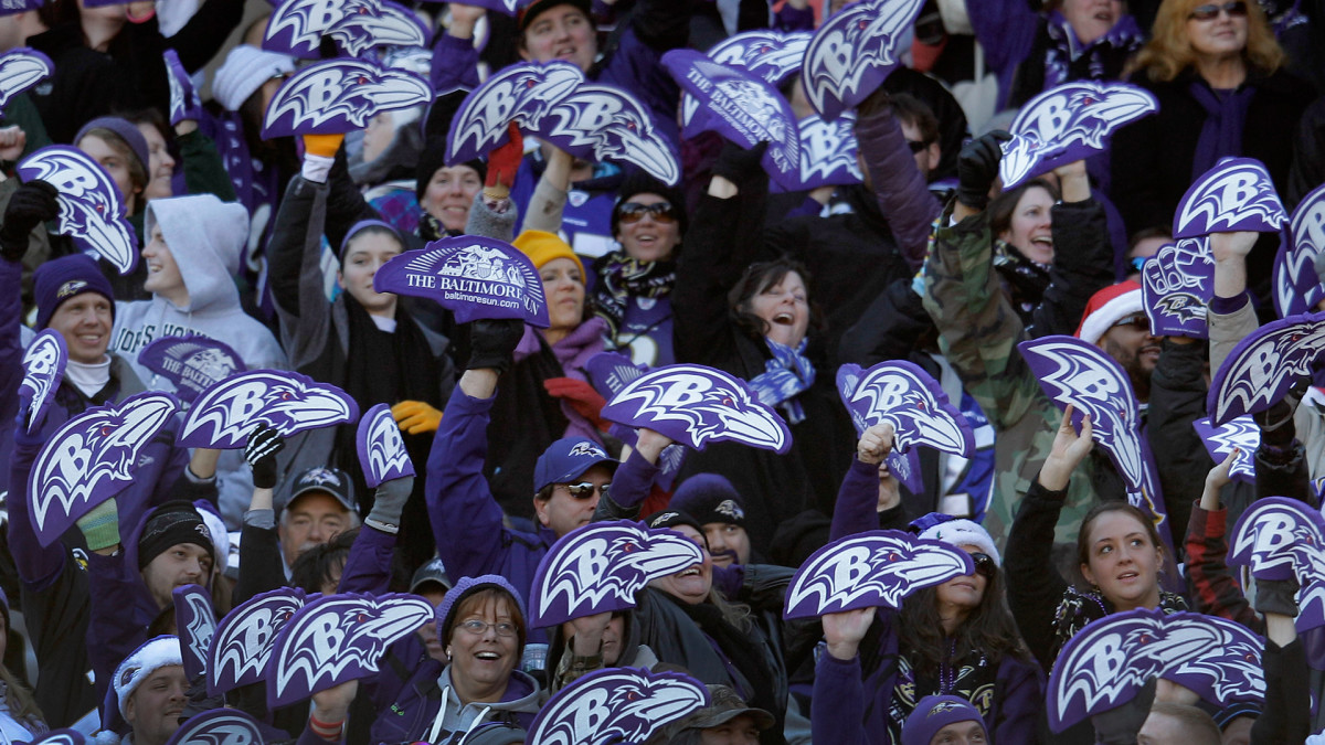 Baltimore Ravens fans hold up foam logos