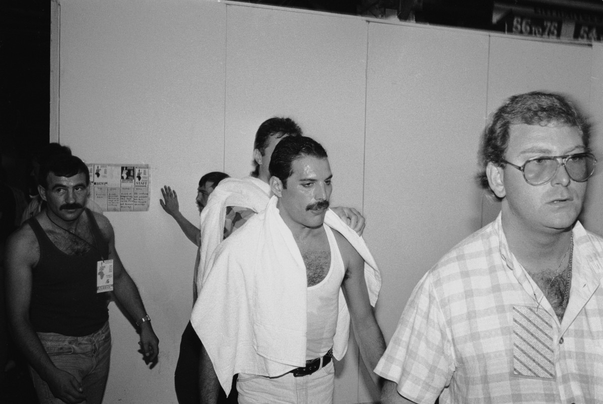 Freddie Mercury backstage at the Live Aid concert in July 1985. On the left is his boyfriend Jim Hutton.