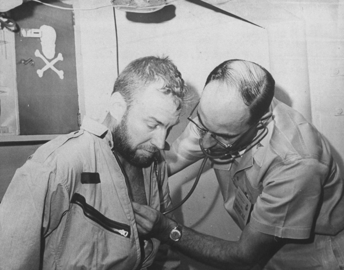 James A. Lovell Jr., undergoing medical tests on USS Wasp after recovery from space capsule of Gemini 7 flight.