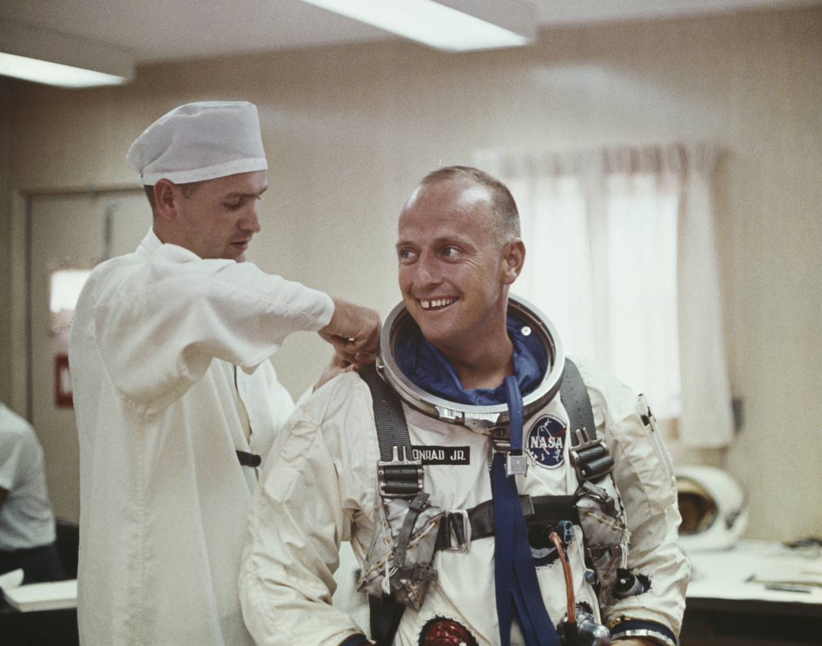 Pete Conrad pictured being assisted in to his Gemini space suit for a Project Gemini training exercise in the United States circa 1965.