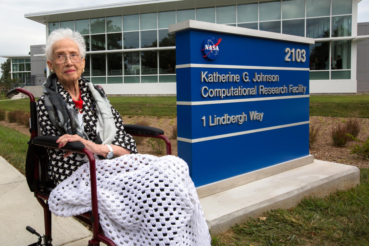 Katherine Johnson in front of the state-of-the-art research facility NASA named in her honor.