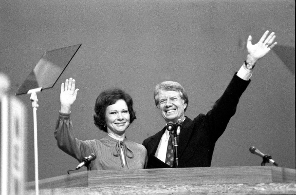 immy and Rosalynn Carter wave to assembled Democratic National Convention after he accepted his party's nomination for presiden