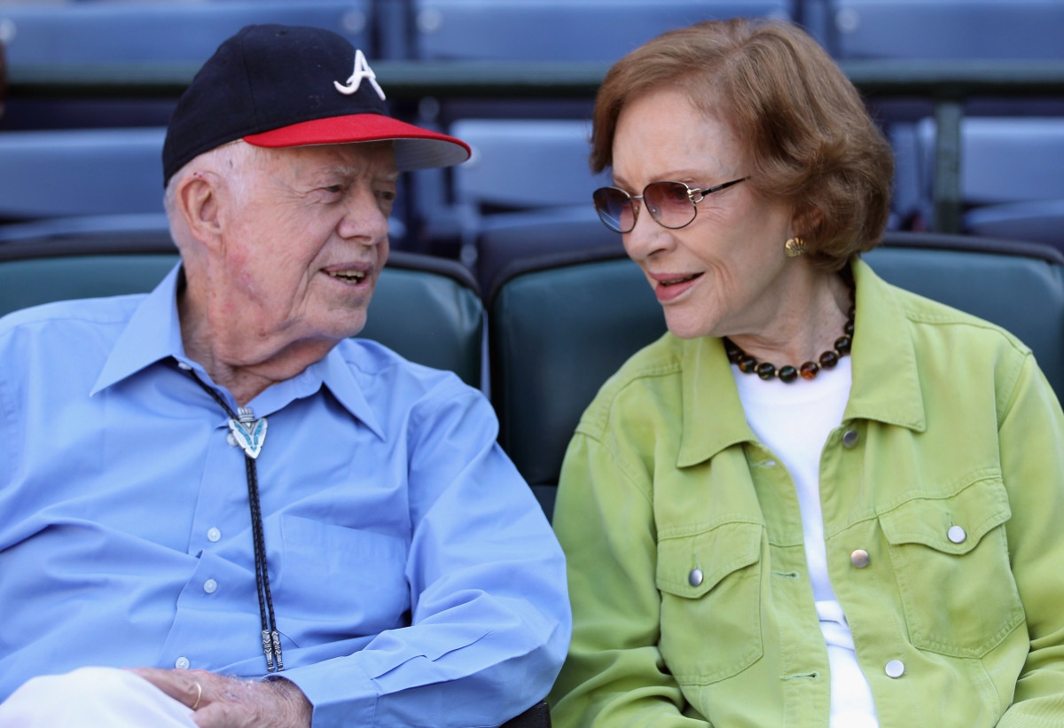 Jimmy Carter and wife Rosalyn converse prior to the start of Game Three of the NLDS of the 2010 MLB Playoffs