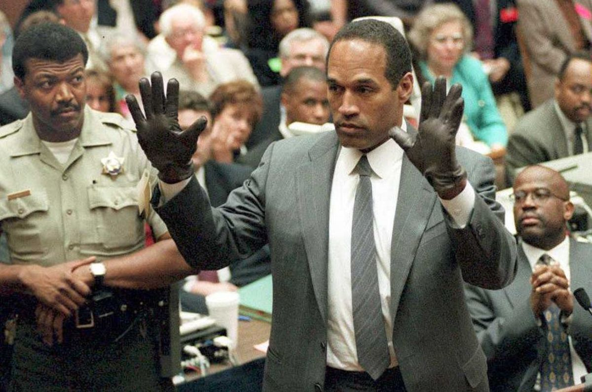 O.J. Simpson trying on gloves during his murder trial