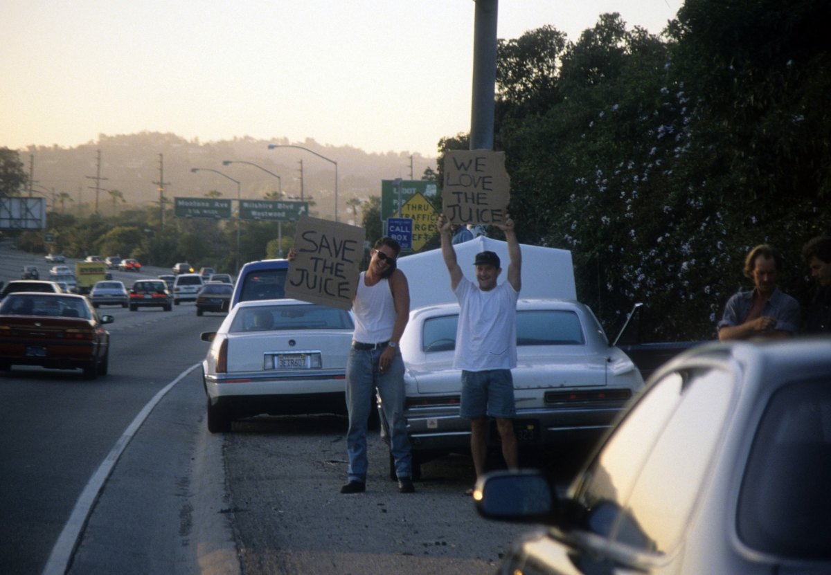 Fans on the side of the street cheering O.J. Simpson on during the Bronco chase