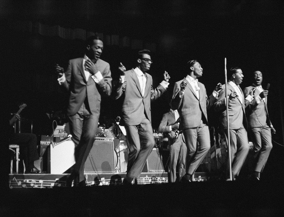 The Temptations perform onstage at the Apollo Theater in 1964 in New York City