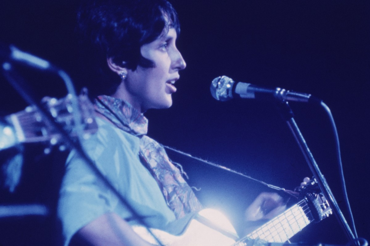 Joan Baez singing and playing the guitar at the Woodstock Music Festival, Bethel, New York.