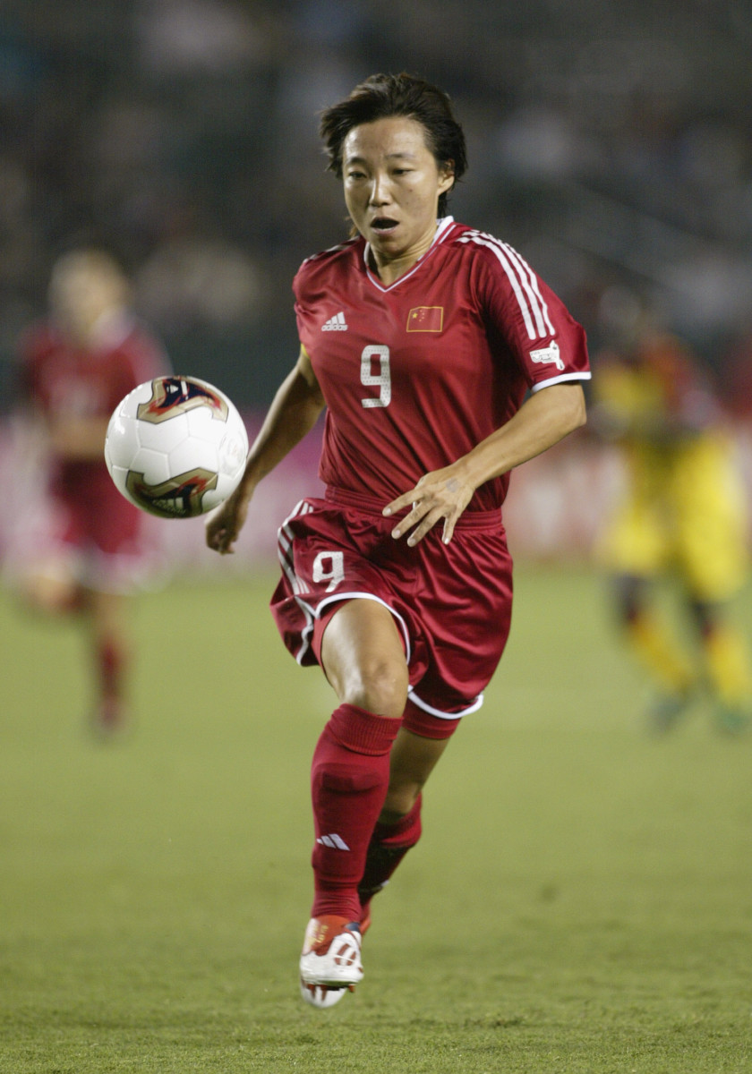 Sun Wen Sun of China advances the ball against Ghana during the first round of the FIFA Women's World Cup at the Home Depot Center in Carson, California on September 21, 2003.