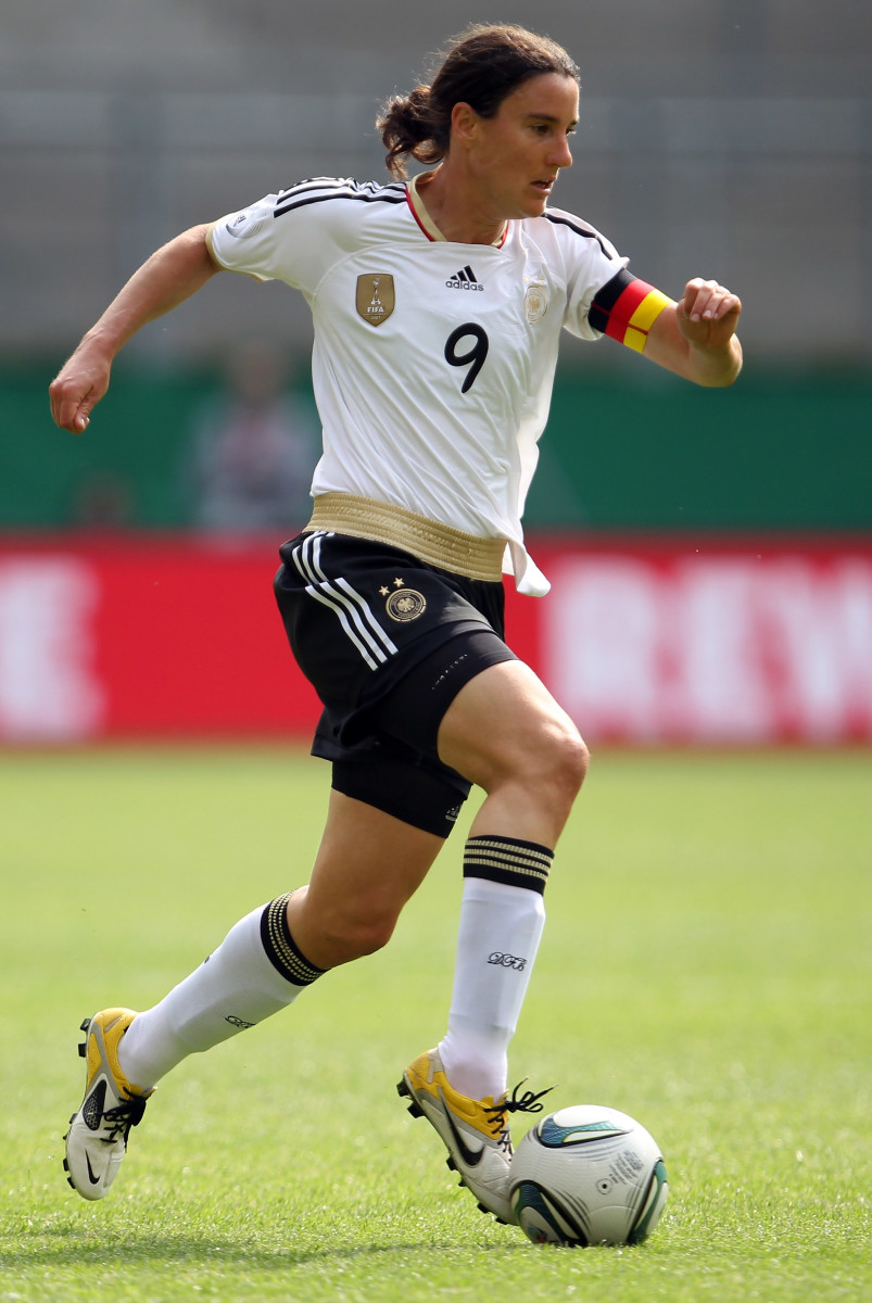 Birgit Prinz runs with the ball during the Women's International friendly match between Germany and Netherlands on June 7, 2011 in Aachen, Germany