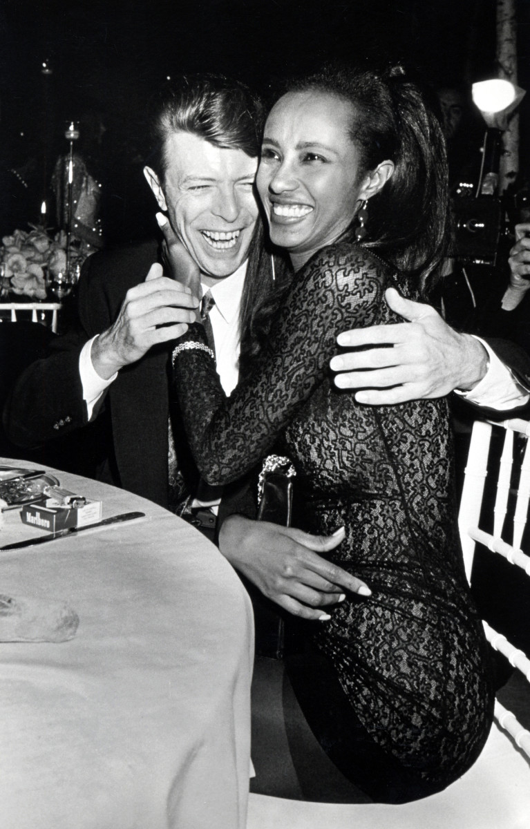David Bowie and Iman laughing and embracing