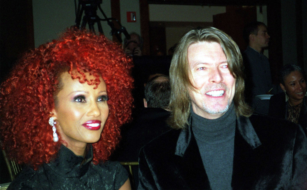 Iman, with bright red hair, with David Bowie, at an Urban League fundraiser