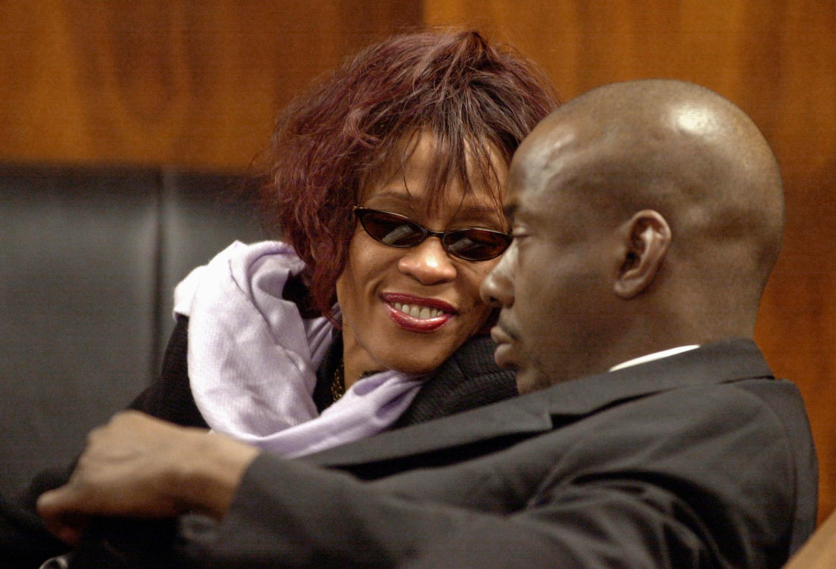 Whitney Houston and Bobby Brown during a court hearing November 25, 2002