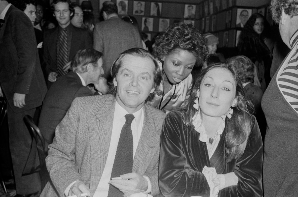 Anjelica Huston seated with Jack Nicholson at Sardis; circa 1960