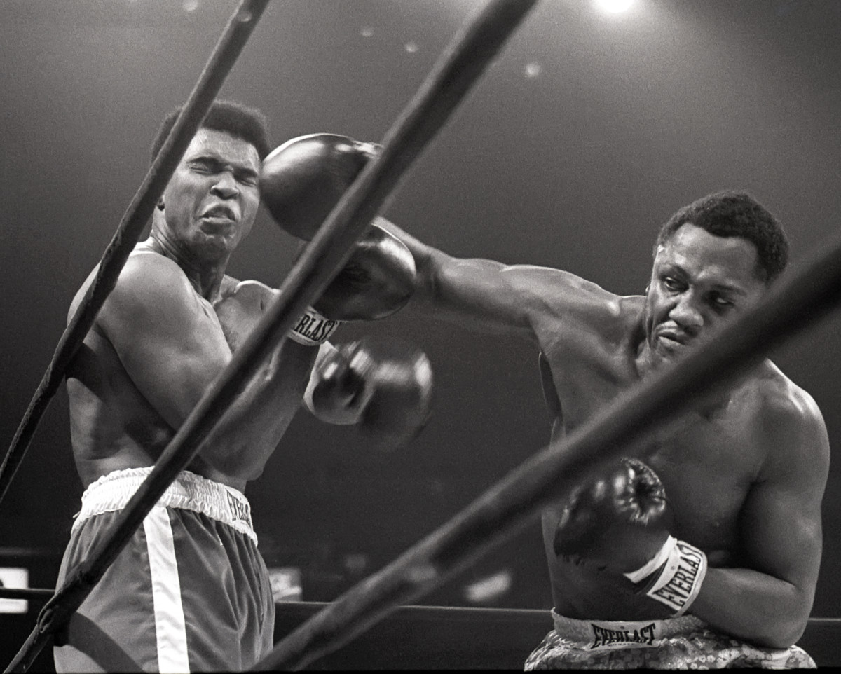 Muhammad Ali takes a hit from Joe Frazier during their heavyweight match in Madison Square Garden