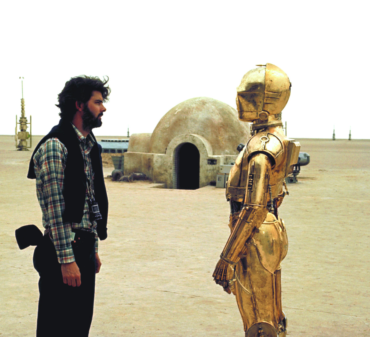George Lucas with C-3PO on the set of Star Wars Episode IV - A New Hope