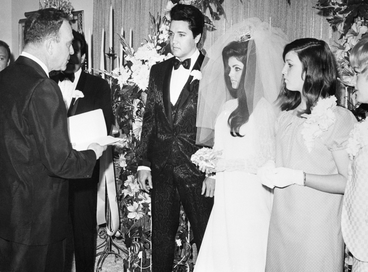 Elvis and Priscilla Presley during their wedding