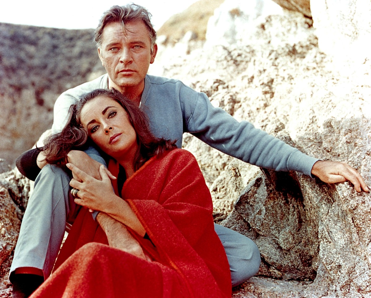 "Elizabeth Taylor and Richard Burton on the film set of ""The Sandpiper"" in 1965"
