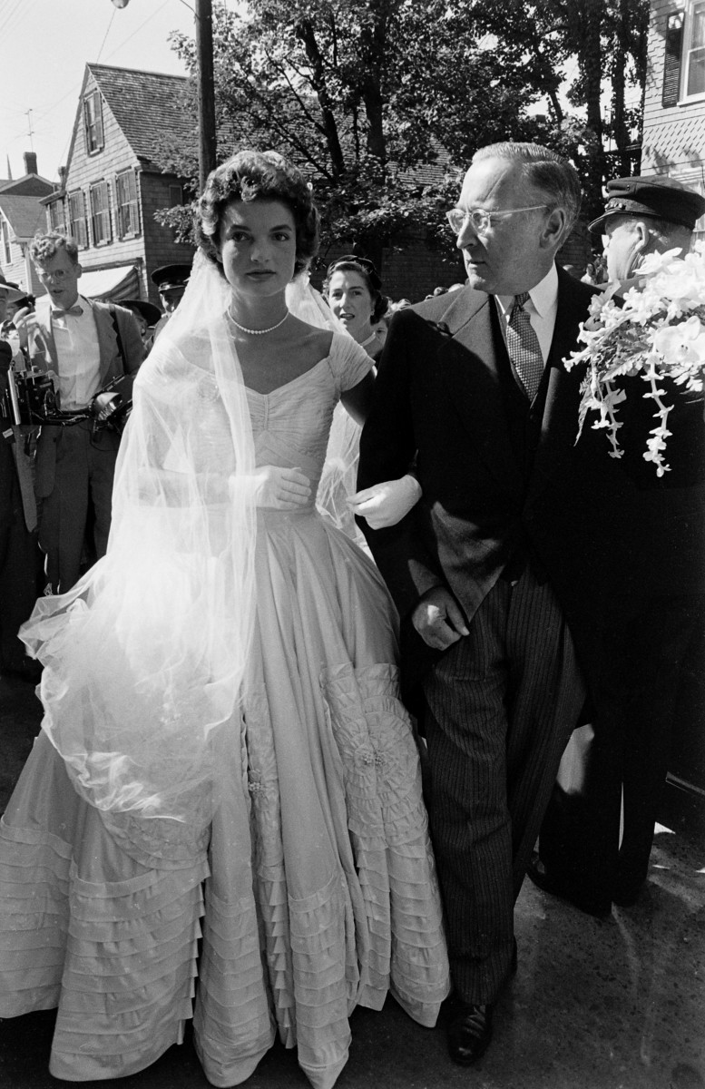 Jacqueline Kennedy is escorted to St Mary's Church by her stepfather, Hugh D Auchincloss for her wedding to John F Kennedy.