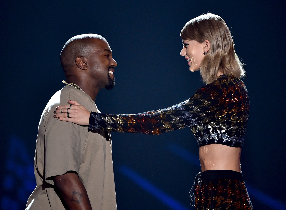 Kanye West accepts the Video Vanguard Award from Taylor Swift onstage during the 2015 MTV Video Music Awards