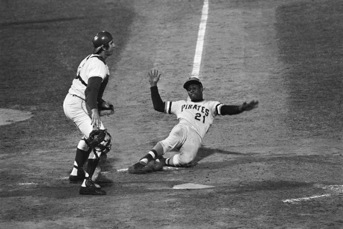 Roberto Clemente sliding into home
