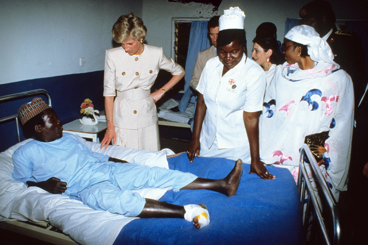 Princess Diana meets a patient during a hospital visit in Cameroon in March 1990
