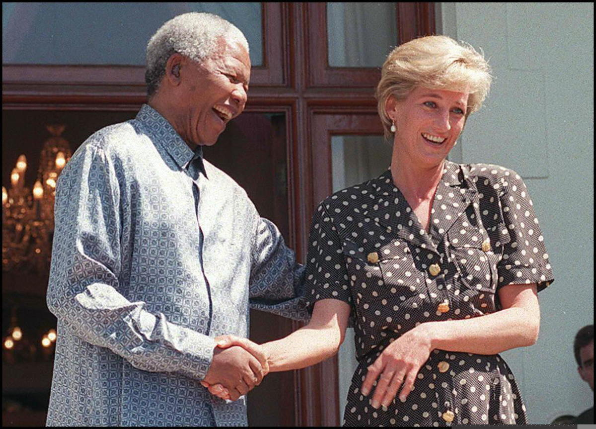 Nelson Mandela and Princess Diana speak with the press after meeting at Mandela's home in Cape Town, South Africa