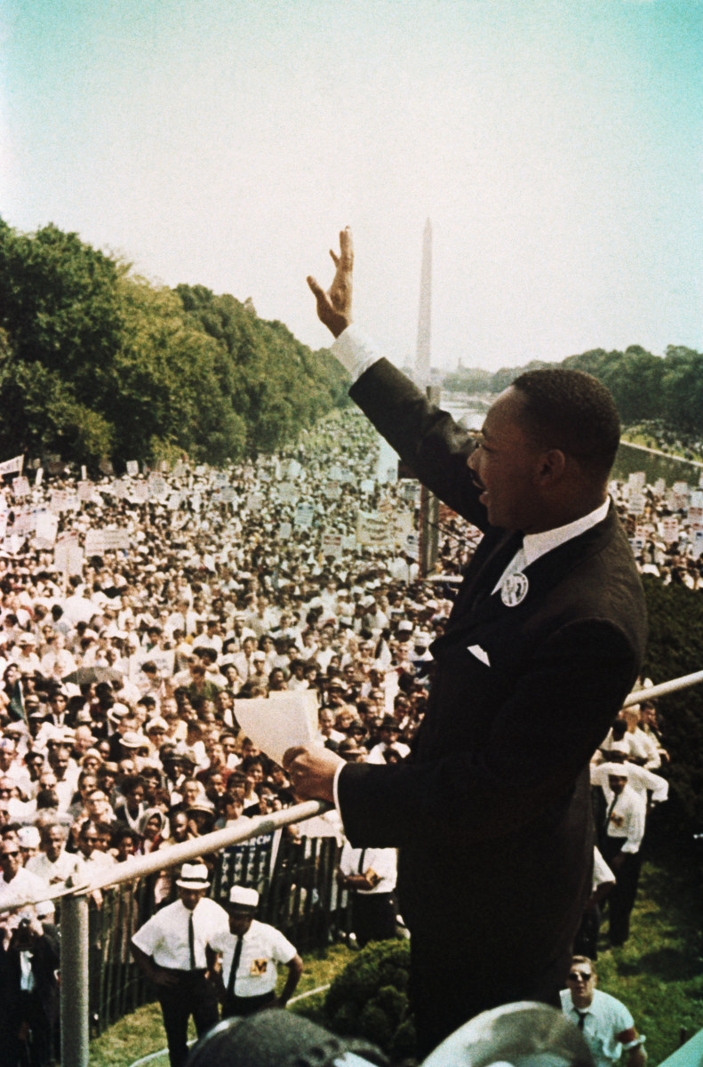 Martin Luther King Jr. waves to participants at the March on Washington on August 28, 1963