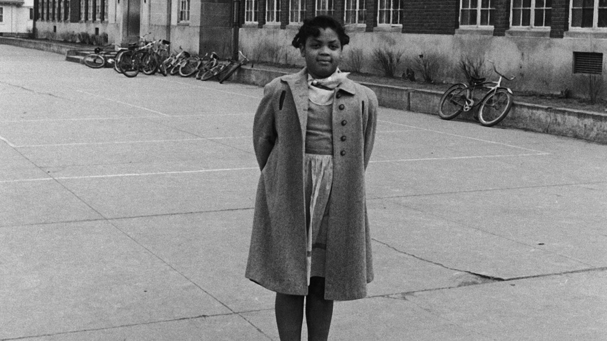 Linda Brown in front of segregated Monroe Elementary School