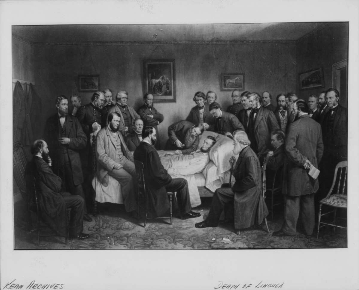 President Abraham Lincoln, surrounded his friends and colleagues in bed following an assassination attempt