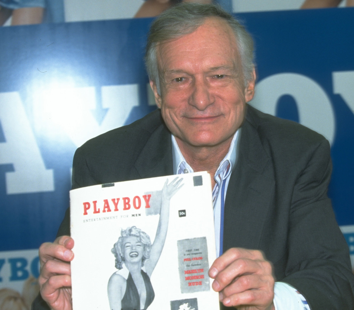 Hugh Hefner holding the first issue of Playboy, featuring Marilyn Monroe on the cover
