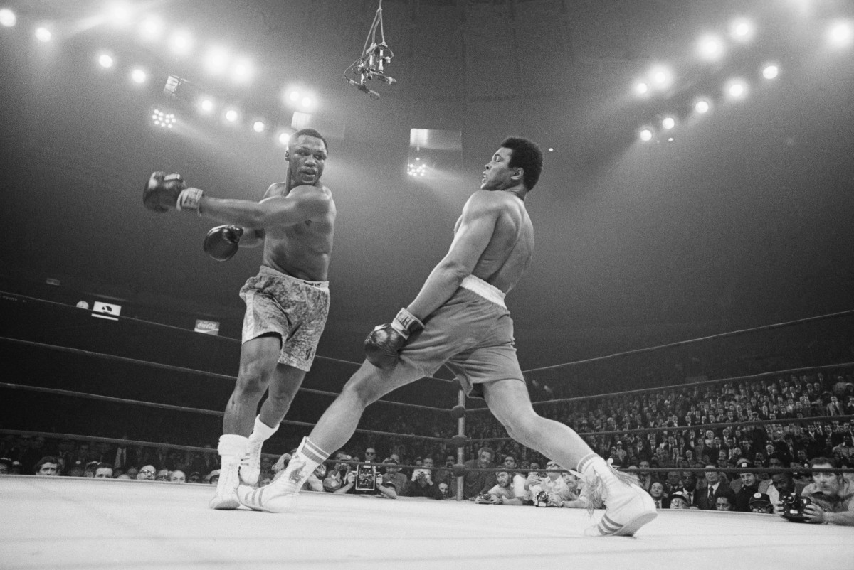 Muhammad Ali steps away from a punch thrown by boxer Joe Frazier during their heavyweight title fight at Madison Square Garden in 1971. Frazier became the undisputed heavyweight champ of the world by winning a unanimous 15-round decision