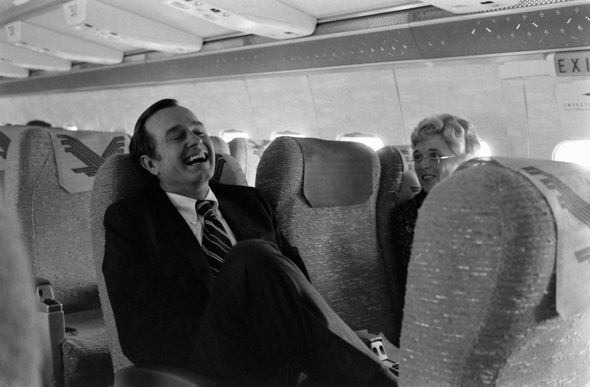 George H. W. Bush sits with his wife, Barbara Bush, on an airplane, Washington D.C., October 1971