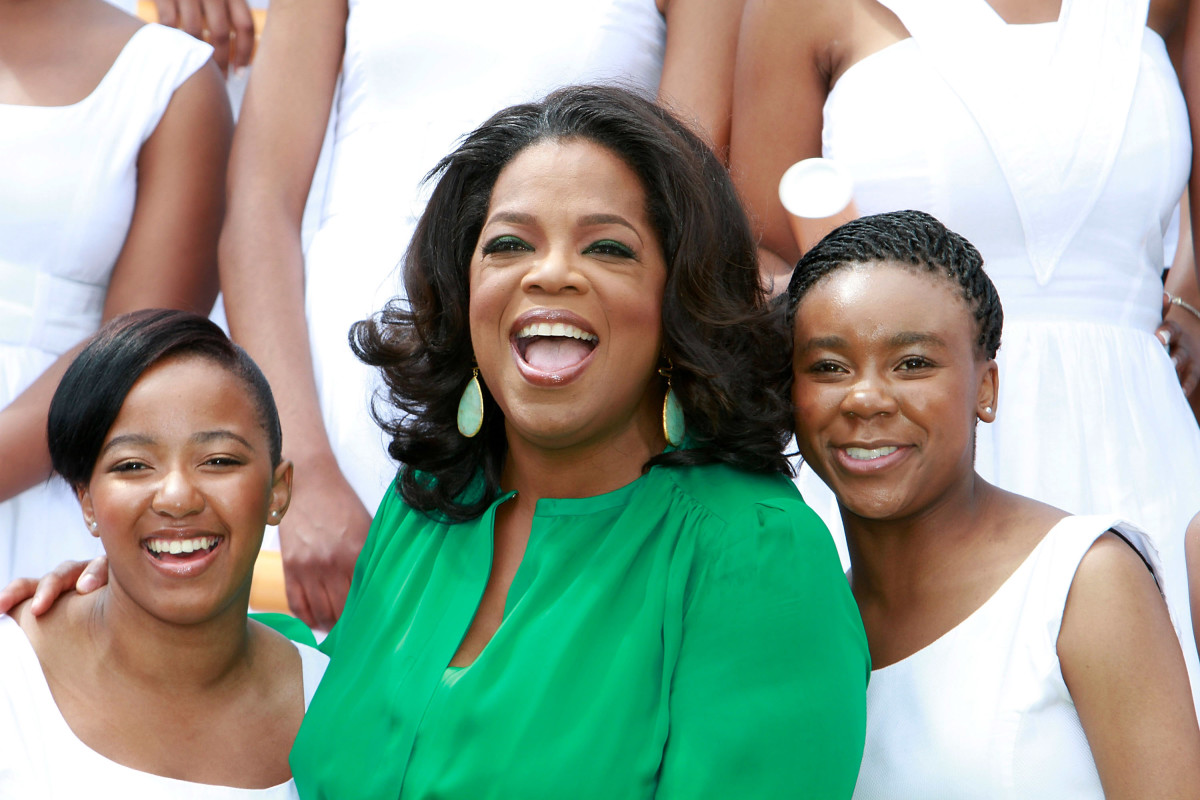 Oprah Winfrey poses with the Graduates on her arrival at the inaugural graduation of the class of 2011 at Oprah Winfrey Leadership Academy for Girls on January 14, 2012 in Henley on Klip, South Africa