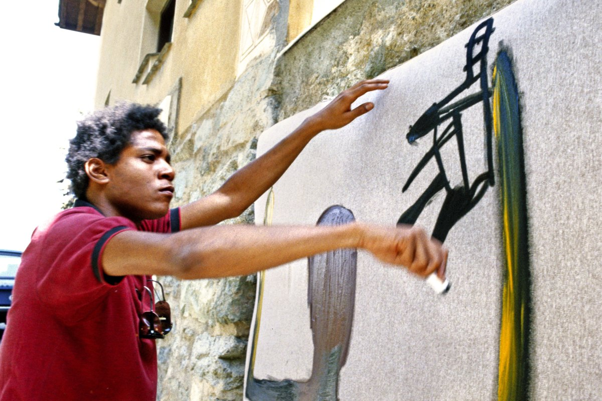 Jean-Michel Basquiat paints in 1983 in St. Moritz, Switzerland
