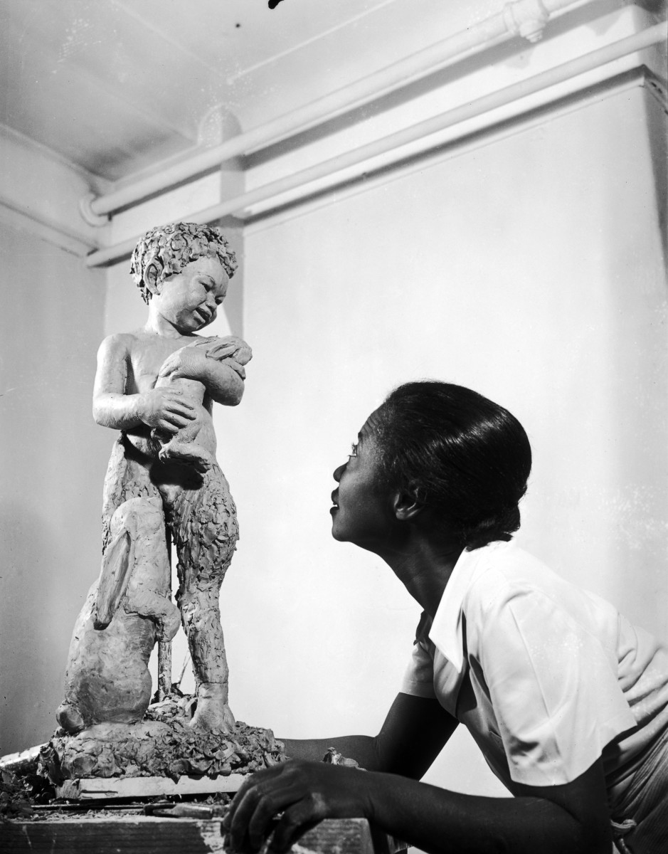 Augusta Savage working on a piece, New York, NY, 1938