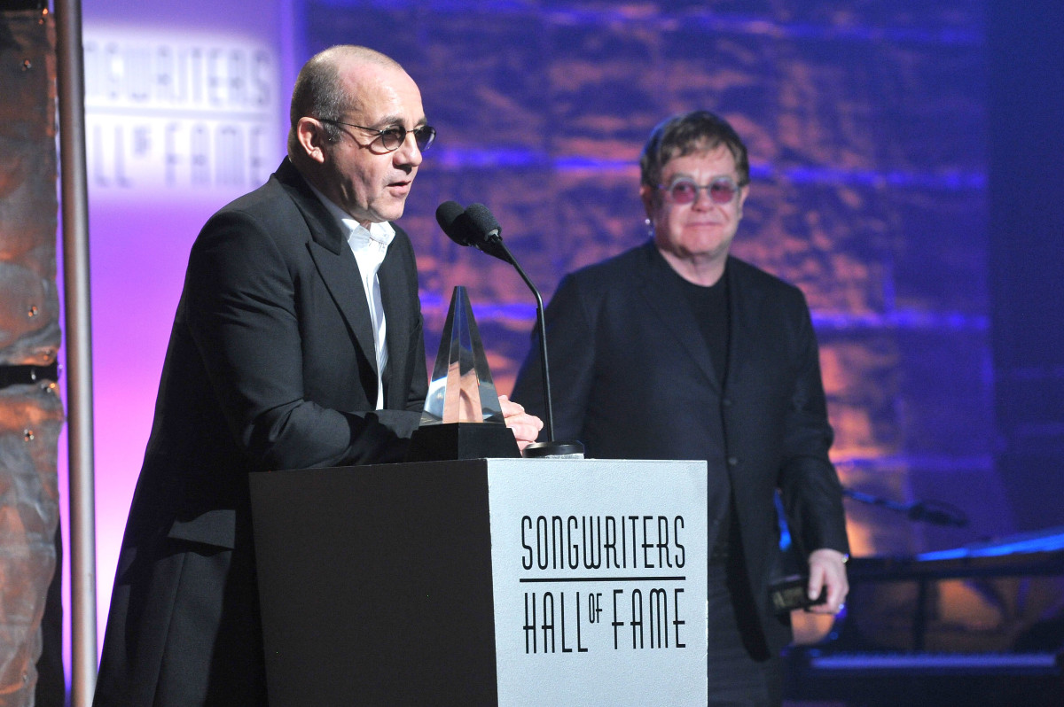 Bernie Taupin and Elton John accept the Mercer Award at the Songwriters Hall of Fame 44th Annual