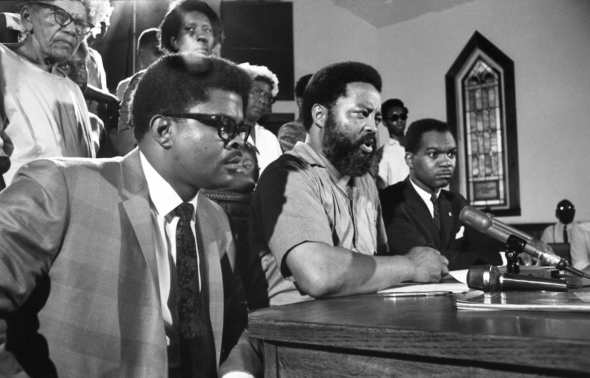 "Reverend Hosea Williams of the Southern Christian Leadership Conference (center) and some of his ""poor people,"" appear at a news conference. Williams, the Reverend W.C. Wales of Cocoa (left), and Walter e. Fauntroy (right) of Washington announced plans for demonstrations to coincide with the launch of Apollo 11. July 14, 1969 (Bettmann Archive/Getty Images)"