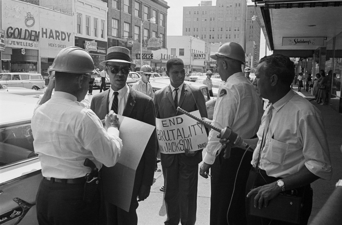 Roy Wilkins (l), Executive Secretary of the NAACP, and Medgar Evers, (c) NAACP field secretary who are picketing outside of a Woolworth's department store in Jackson, Mississippi.